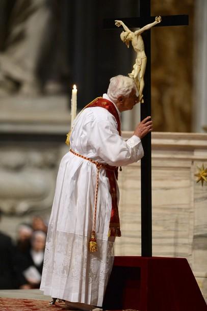 Pope Benedict XVI kisses the cross durin