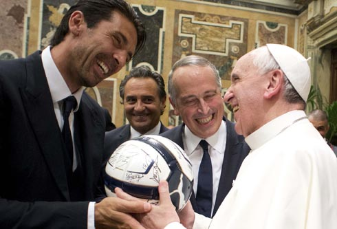 Pope Francis receives soccer ball as gift from Italy's goalkeeper Buffon during private audience at Vatican