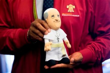 Philadelphia Mayor Michael Nutter displays a Pope Francis doll during a news conference, Monday, June 1, 2015, in Philadelphia. Aramark has been named the official retail provider of event merchandise for the scheduled Eighth World Meeting of Families Congress and Papal Visit to Philadelphia in September. (AP Photo/Matt Rourke)