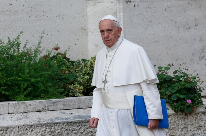 Pope Francis arrives for morning session of Synod of Bishops on the family at Vatican