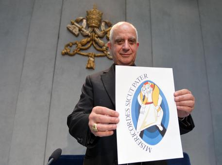 Mons. Rino Fisichella, President of the Pontifical Council for the New Evangelization, showing the logo of the Jubilee of Mercy, announced by Pope Francis on March 13th 2015. It will be open from December 8th 2015 to November 20th 2016. Rome, May 5th 2015. ANSA/MAURIZIO BRAMBATTI