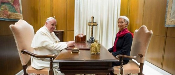 Pope Francis (L) poses with International Monetary Fund Managing Director Christine Lagarde during a meeting at the Vatican December 10, 2014. REUTERS/Osservatore Romano (VATICAN - Tags: RELIGION BUSINESS) ATTENTION EDITORS - THIS PICTURE WAS PROVIDED BY A THIRD PARTY. FOR EDITORIAL USE ONLY. NOT FOR SALE FOR MARKETING OR ADVERTISING CAMPAIGNS. THIS PICTURE IS DISTRIBUTED EXACTLY AS RECEIVED BY REUTERS, AS A SERVICE TO CLIENTS. NO SALES. NO ARCHIVES