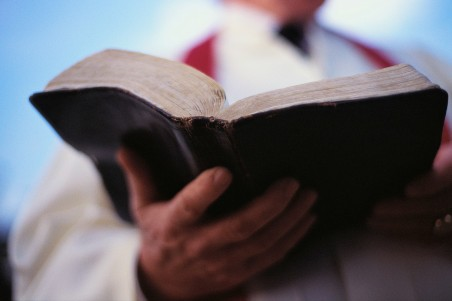 Pastor Holding Bible ca. 2000
