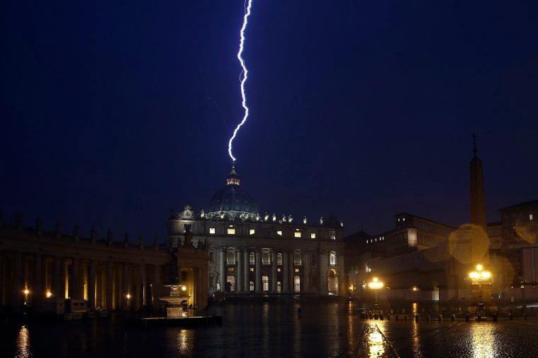 A flash of lighting is seen over St.Peter's Basilica during a rainstorm at Vatican in this picture provided by Ansa on February 11, 2013. Pope Benedict stunned the Roman Catholic Church on Monday when he announced he would stand down, the first pope to do so in 700 years, saying he no longer had the mental and physical strength to carry on. REUTERS/ANSA/ Alessandro Di Meo ( VATICAN - Tags: RELIGION) ATTENTION EDITORS - NO COMMERCIAL USE. NO MAGS. NO SALES. NO ARCHIVES. FOR EDITORIAL USE ONLY. NOT FOR SALE FOR MARKETING OR ADVERTISING CAMPAIGNS. THIS IMAGE HAS BEEN SUPPLIED BY A THIRD PARTY. IT IS DISTRIBUTED, EXACTLY AS RECEIVED BY REUTERS, AS A SERVICE TO CLIENTS. ITALY OUT. NO COMMERCIAL OR EDITORIAL SALES IN ITALY