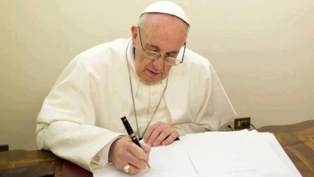 Pope-Francis-writing-740x493