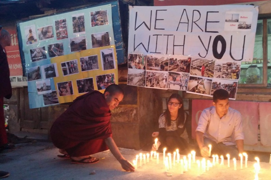 Exile Tibetans light candles during a solidarity gathering for the victims of the Nepal earthquake, in McLeod Ganj, India, on 26 April 2015.