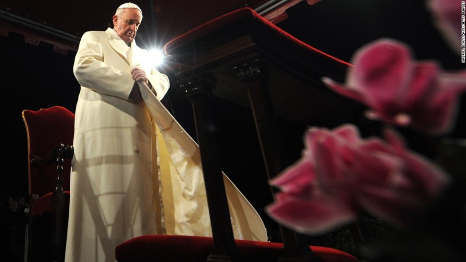 "Pope Francis puts his coat on during the celebration of the Way of the Cross on Good Friday on March 29, 2013 at the Colosseum in Rome. Pope Francis presided over his first Good Friday which will culminate in a torch-lit procession at Rome's Colosseum and prayers for peace in a Middle East ""torn apart by injustice and conflicts"". AFP PHOTO / GABRIEL BOUYS (Photo credit should read GABRIEL BOUYS/AFP/Getty Images)"