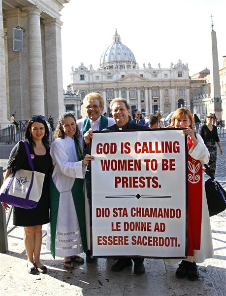 "Father Roy Bougeois from Georgia (2nd R) poses with a group of Roman Catholic activist in front of the Vatican October 17, 2011. The group who think women should be ordained priests were detailed by police on Monday when they tried to demonstrate at the Vatican and deliver a petition. Witnesses said Italian police stopped the group of about 20 demonstrators and confiscated a banner reading ""God is calling women to be priests"". REUTERS/Max Rossi (ITALY - Tags: RELIGION)"