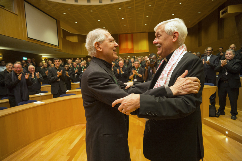 Jesuit Father Arturo Sosa, right, the new superior general of the Society of Jesus, greets the previous superior general, Jesuit Father Adolfo Nicolas, after his election in Rome Oct. 14. Father Sosa, 67, is a member of the Jesuits' Venezuelan province. (CNS photo/Don Doll, S.J.) See JESUITS-ELECTION-GENERAL Oct. 14, 2016.