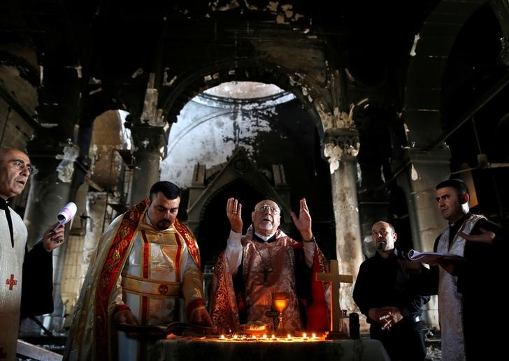 Iraqi priests hold the first Sunday mass at the Grand Immaculate Church since it was recaptured from Islamic State in Qaraqosh, near Mosul, Iraq, October 30, 2016. REUTERS/Ahmed Jadallah
