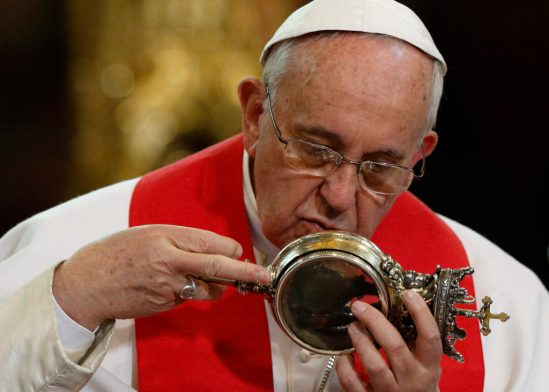 Pope Francis kisses a reliquary containing what is believed to be the blood of St. Januarius during a meeting with religious at the cathedral in Naples, Italy, March 21. The dried blood of the saint is said to liquefy several times a year. After the pope handled the relic, the blood apparently liquefied. (CNS photo/Paul Haring) See POPE-NAPLES and POPE-JANUARIUS March 23, 2015.